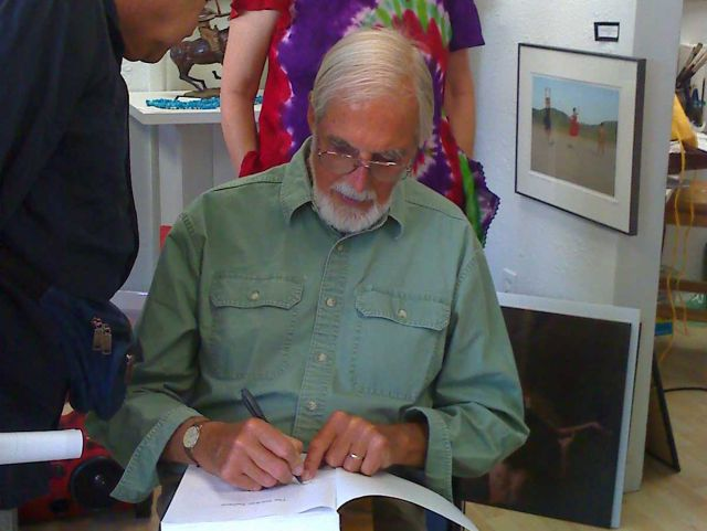 John Alan Ross signing a copy of the book